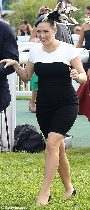 Watch your step: Kate's towering heels meant walking over the grass could be rather treacherous