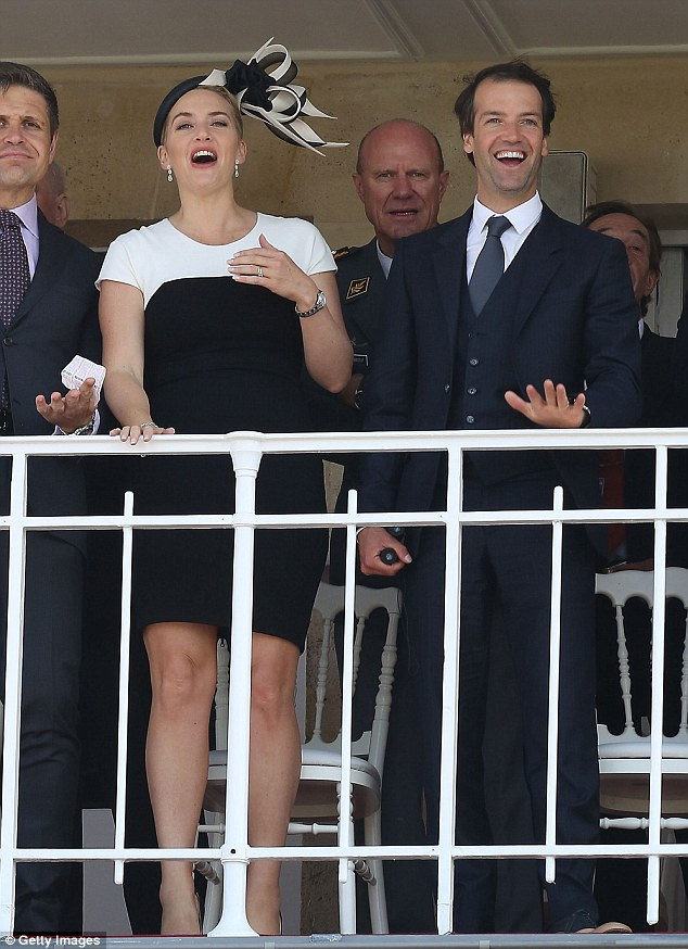Cheers: The married couple seemed to be in high spirits on Sunday