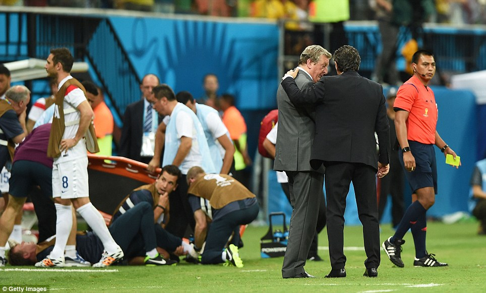 He shoots, he slips: With little known about the protocol for injured medics, Lewin was quickly surrounded by a crowd of around a dozen staff from both sides and FIFA
