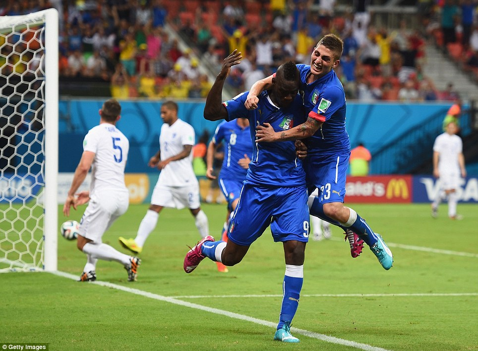 A groan for England: Mario Balotelli celebrates with Marco Verratti after the second goal for Italy during the first-round clash