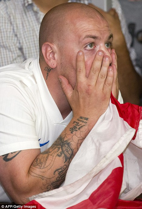 An England supporter reacts in the Walkabout bar in central London as England slip 2-1 behind