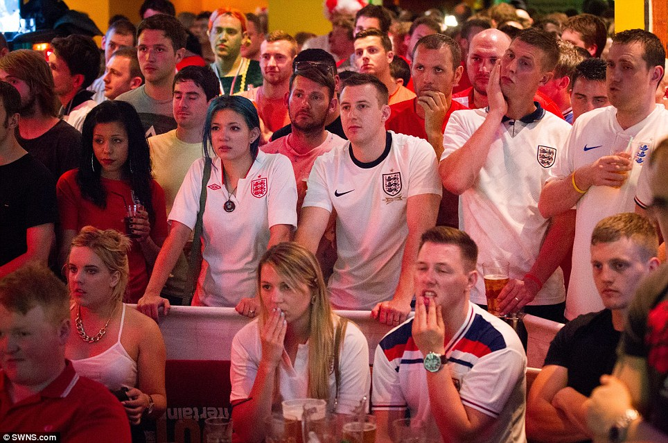 Nail-biter: Exhilaration among the fans in a sports bar in Bristol did not last long after Mario Balotelli broke through England's defences to bring the score to 2-1