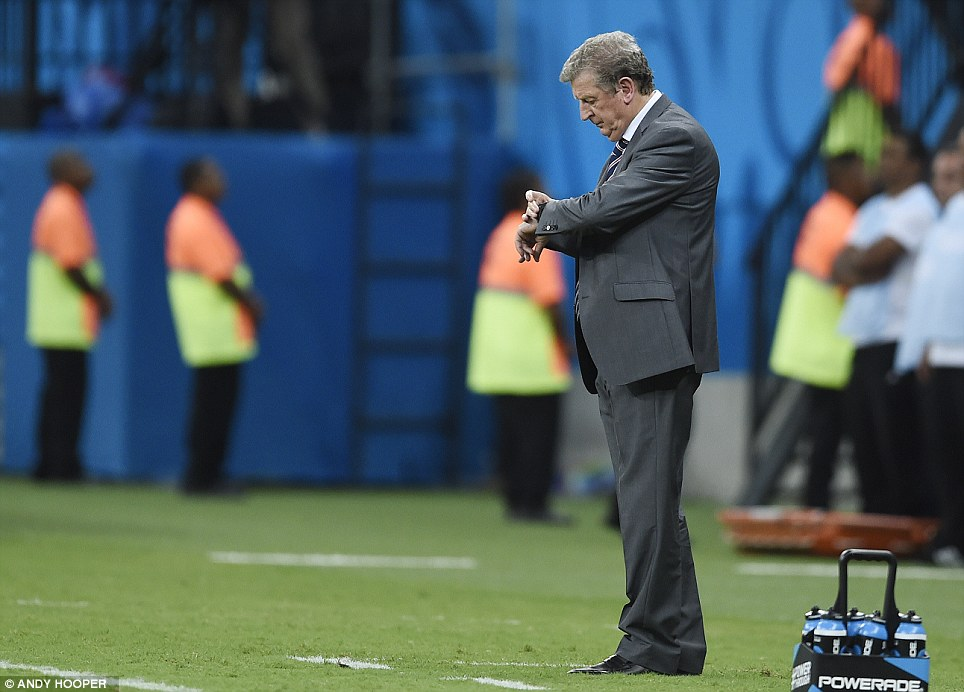 Time's running out: Roy Hodgson checks his watch in the match's closing minutes when England's chances of victory began to look increasingly bleak