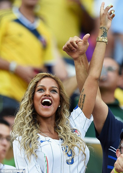 The happiest woman in Manaus: Mario Balotelli's fiancée Fanny Neguesha celebrated at the stadium as the Italian star pulled Italy forward 2-1 to victory