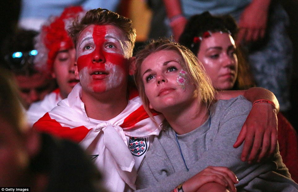 Misery: An England fan at the Isle of Wight Festival can barely hide his disappointment as he watches victory slip from the grasp of the national side in the final minutes