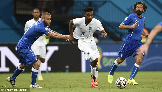 Getting to grips with him: De Rossi tries to stop Sturridge by grabbing the England striker's shirt