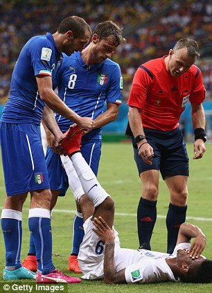 Helping hand: Italians Giorgio Chiellini and Marchisio come to Sterling's aid
