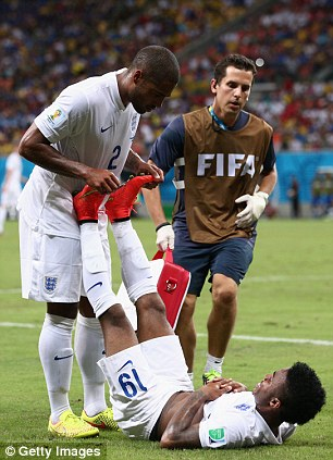 Cramp: Glen Johnson tries to help Sterling