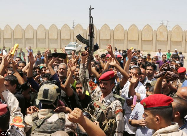 Volunteers: Thousands of Iraqi men in Baghdad queued for hours to sign up to fight the ISIS militants