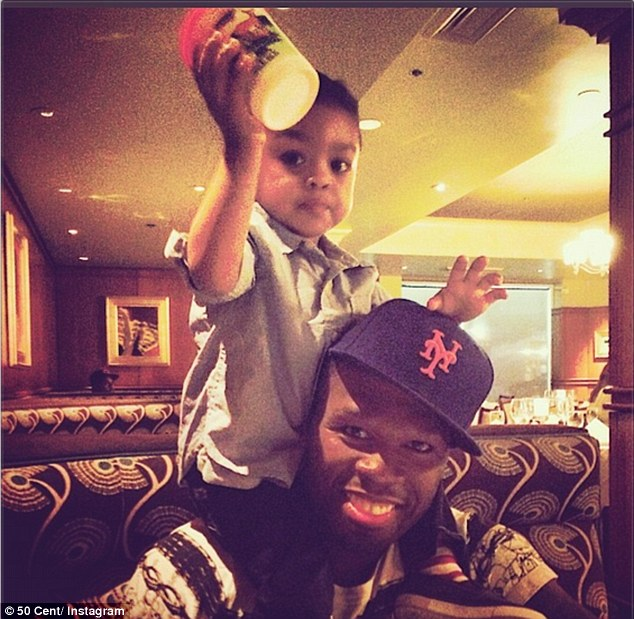 'Try to avoid unproductive, unhappy people': 50 Cent imparted a little wisdom on Father's Day as he posed with his son
