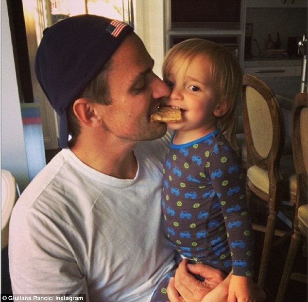'Pancakes taste even better with Daddy!' Giuliana Rancic shared this photo of her son Duke sharing a breakfast snack with her husband Bill