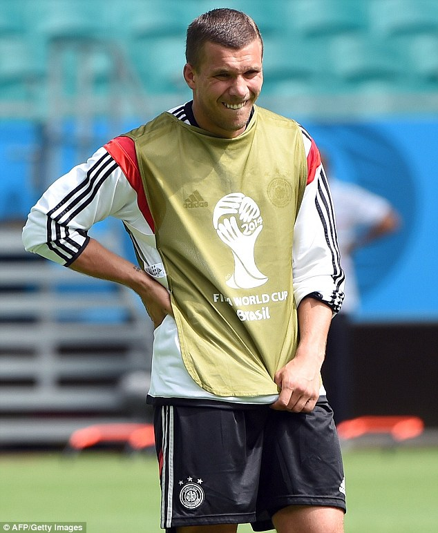 Striker: Podolski says 'if we win the World Cup then it is something which could give him some joy'