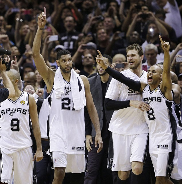 Tony Parker (9), Tim Duncan (21), Matt Bonner and Patty Mills (8) of the Spurs celebrate their victory in Game 5 of the NBA Finals and the fifth championship all-time for the franchise