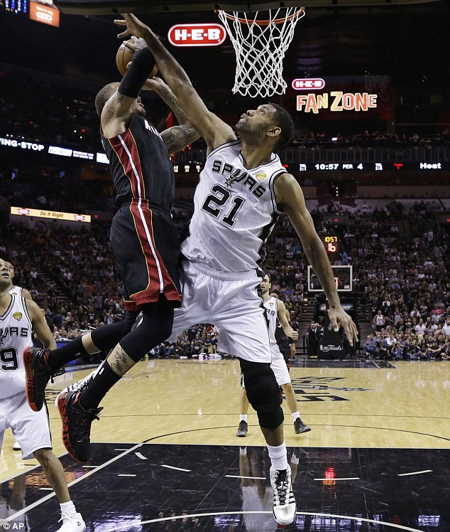 Heat forward Michael Beasley (pictured left) shoots as Tim Duncan attempts to block the shot. Tim Duncan has been playing as a forward for the Spurs for all five of their championship victories