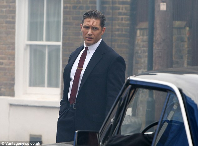 Dapper: Hardy wore a smart two-piece suit, crisp white shirt and maroon pencil tie for his role as feared gangster Reggie Kray