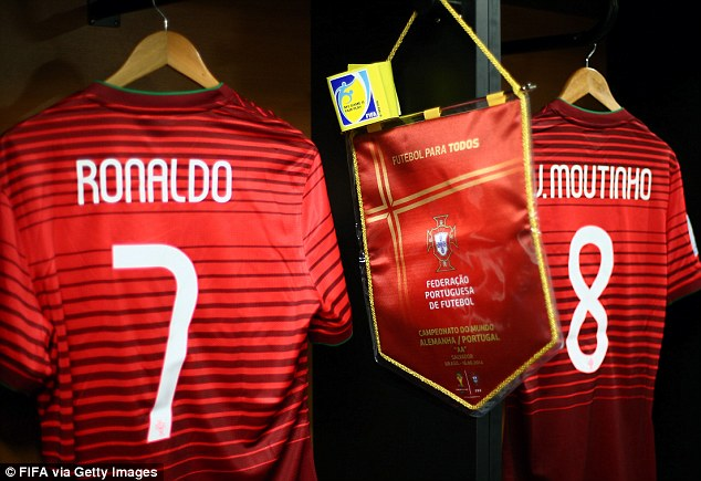 Get shirty! Cristiano Ronaldo's strip hangs in the dressing room ahead of Portugal's opening World Cup game