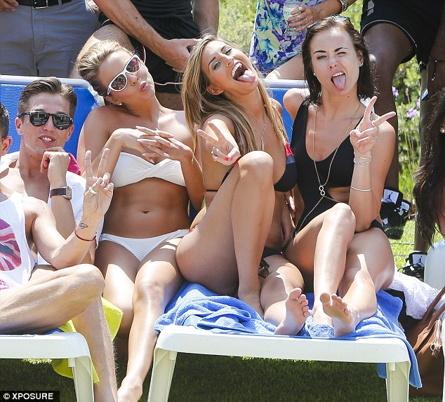 SHe's perked up: Ferne McCann looked pretty happy despite having a bust up with her boyfriend Charlie Sims, and his sister Chloe, during the trip