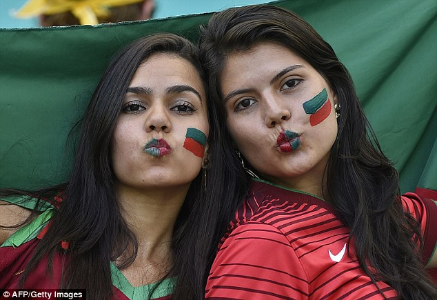Portugals! A pair of Portuguese lady supporters pucker up before the start of the game at the Fonte Nova Arena