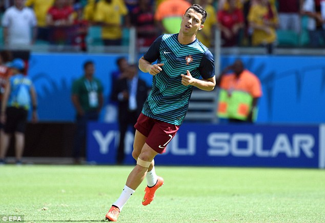 Portugeezer! Cristiano Ronaldo warms up ahead of their Group G game against Germany