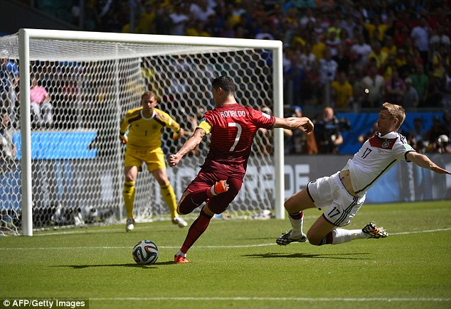 First blood: Cristiano Ronaldo hits his opening shot on target with a low drilled effort that's saved by Manuel Neuer