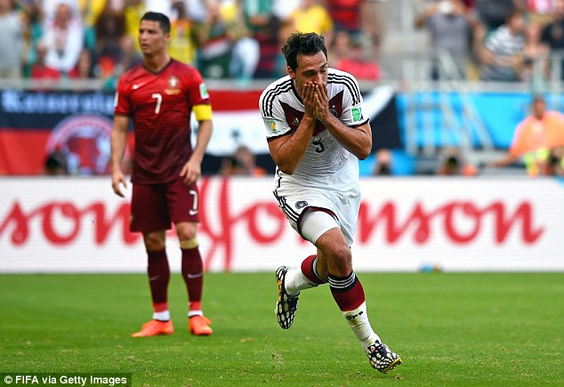 Using his head: Germany defender Mats Hummels wheels away after doubling his side's lead from a corner