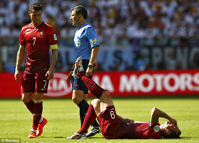 Man down: Cristiano Ronaldo looks on as a knock forces Portugal striker Hugo Almeida to be taken off