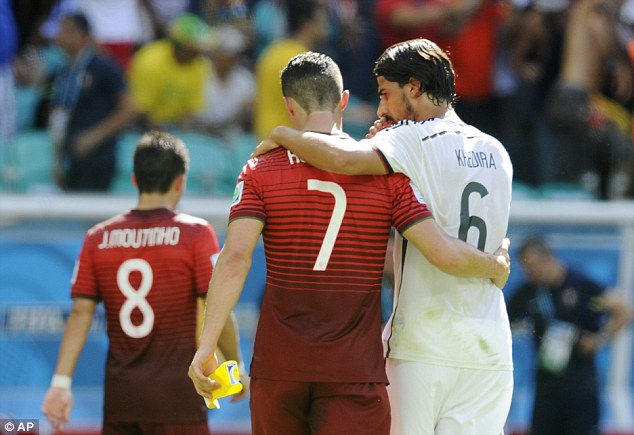 Lean on me: Cristiano Ronaldo is consoled by Real Madrid teammate Sami Khedira at half-time