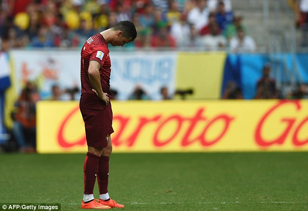 Cristiano Ronaldo looks dejected after Portugal lose their opening World Cup game 4-0 to Germany