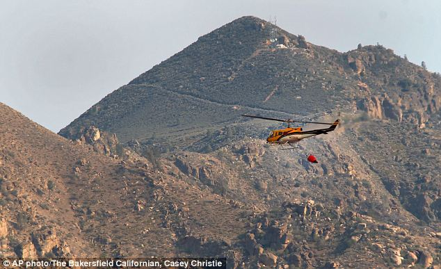 Several helicopters including this one were getting their water from Isabella Lake before dropping it on the fire