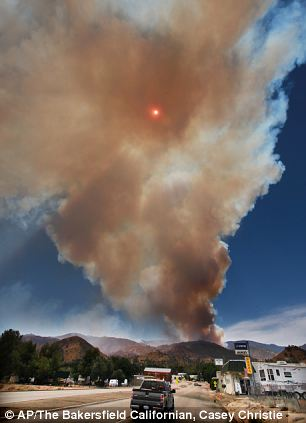A plume of smoke blocks out the sun in Wofford Heights, California, as a wildfire rages out of control in and around the Sequoia National Forest