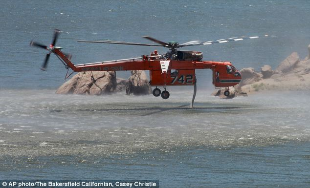 An Erickson Air-Crane loads up from Isabella Lake before making another water drop on the Shirley Fire
