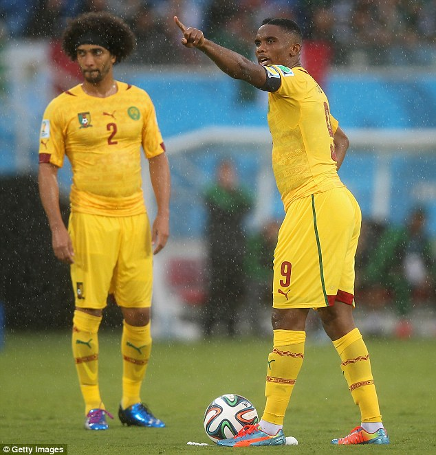 Blow: Benoit Assou-Ekotto (left) and his Cameroon team-mates will be without Eto'o (right) against Croatia