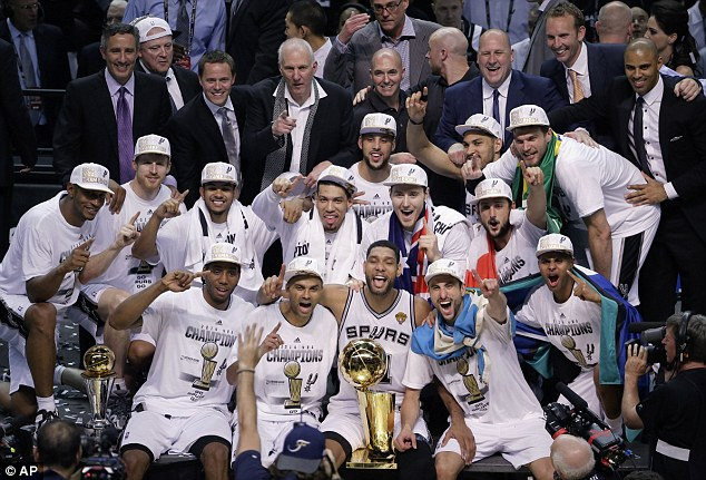 The Spurs pose for a team photo in their celebration of the franchise's fifth championship