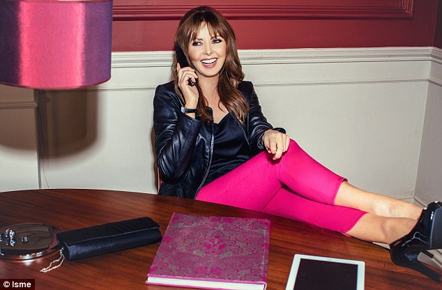 Looking good! Carol Vorderman has been unveiled as the face of Isme's AW14 range (leather jacket, £140, vest top, £5, pink capri pants, £29, clutch bag, £16)