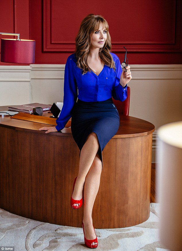 Poster girl: Carol has long maintained that fashion isn't about age and believes you should dress however you like (blue blouse, £29, pencil skirt, £20, red peep toe heels, £30)