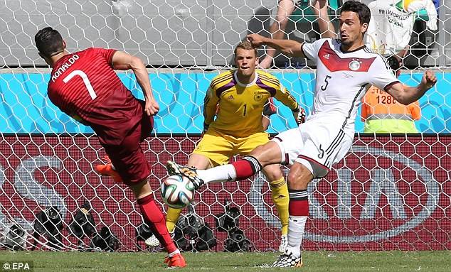Keeping him out: Hummels (right) goes to block a Ronaldo shot on goal