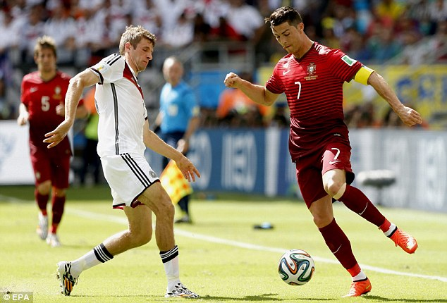 It's one on one: Ronaldo faces up Muller and attempts to beat the Germany forward