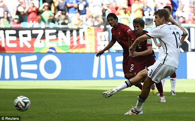 Spot on: Muller dispatches the penalty into the corner with ease to set Germany on their way