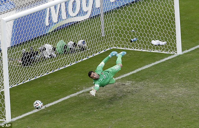 Out of reach: Portugal keeper Rui Patricio dives but can get nowhere near Muller's penalty