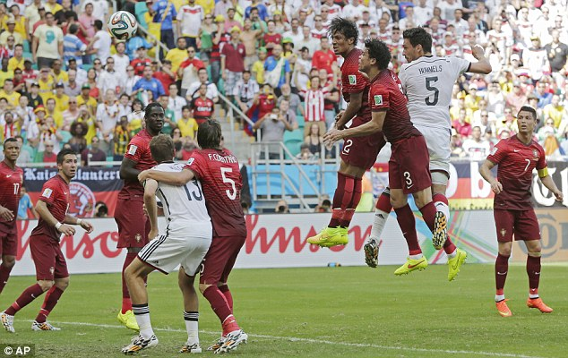 Heading for an easy win: Mats Hummels (second right) rises to nod in Germany's second goal