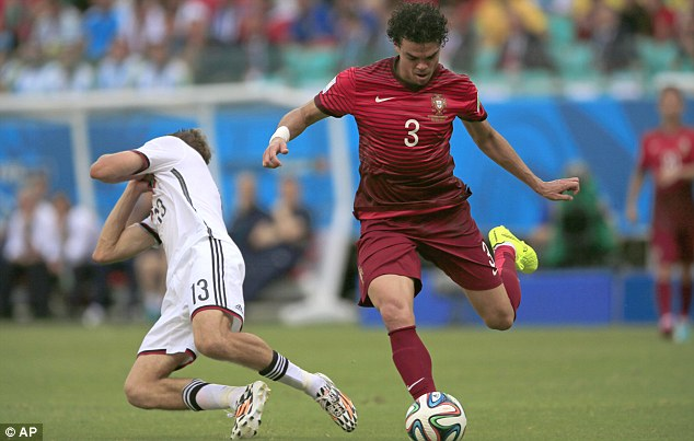 Theatrics: Muller (left) flings himself to the floor holding his face as Pepe plays on