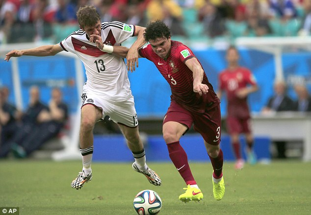 Not much in it: Thomas Muller (left) is caught by Pepe's flailing arm duirng the first half