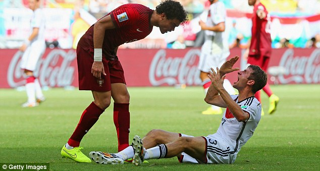 Startled: Muller reacts in shock and disbelief after Pepe's ridiculous headbutt