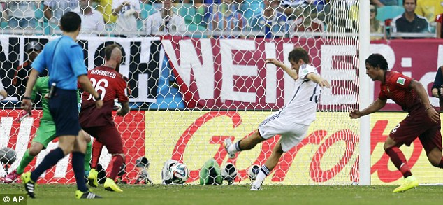 Three and easy: Thomas Muller (centre) lashes home Germany's third and put them in total control
