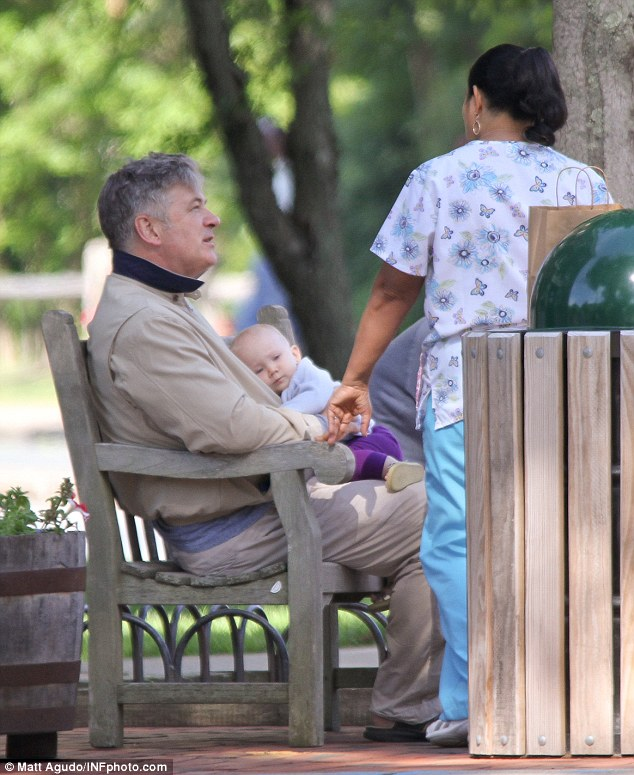 Father-daughter day: Alec Baldwin enjoyed some quality time at the park in The Hamptons, New York on Monday with his 10-month-old baby girl Carmen