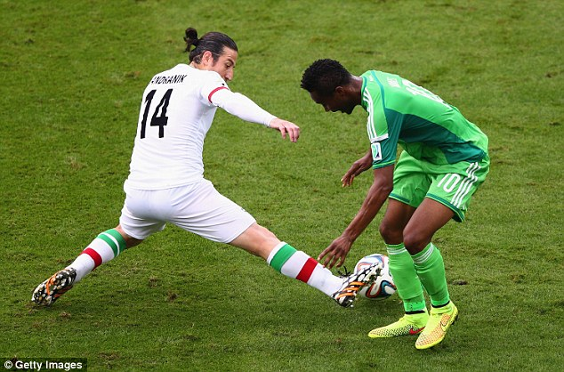 Lost out: John Obi Mikel loses possession as Andranik nips into to take the ball away
