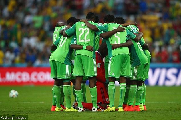 Team effort: Nigeria huddle around goalkeeper Vincent Enyeama ahead of kick-off