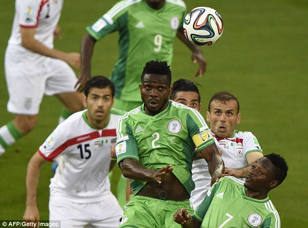 Eyes on the prize: Former Everton defender Joseph Yobo climbs highest to win the ball in the air