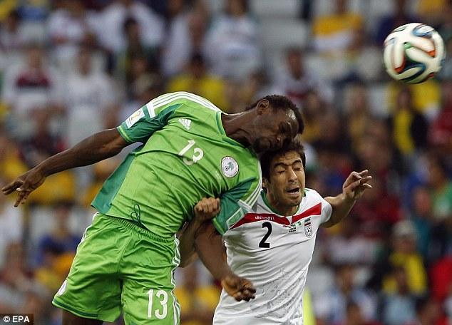 Leaning: Nigeria's Juwon Oshaniwa gets the better of Iran's Khosro Heydari in the air