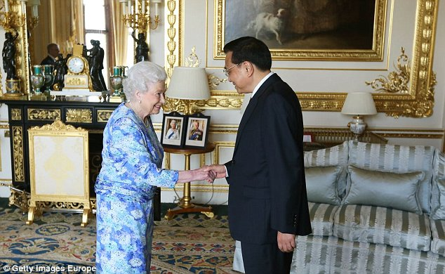 WINDSOR, ENGLAND - JUNE 17:  Queen Elizabeth II receives Chinese premier Li Keqiang at Windsor Castle, during their visit to the UK on June 17, 2014 in Windsor, England. During his first official visit to the UK Mr Li will meet the Prime Minister at Downing Street and attend a Global Economy Roundtable. At the start of Mr Li's three-day visit, the Home Office announced a new visa service, to be offered to all Chinese visitors to the UK following a pilot programme for tour operators last year. (Photo by Steve Parsons - WPA Pool/Getty Images)